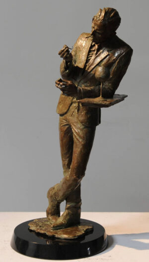 Man lighting a cigarette at bar (sculpture)