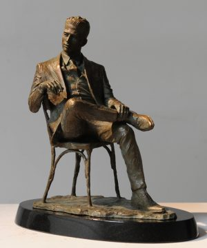 Man sitting in a Chair sculpture