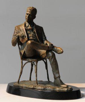 Man in a Chair sculpture