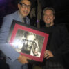 Jeff Goldblum standing next to portrait by Fabian Perez