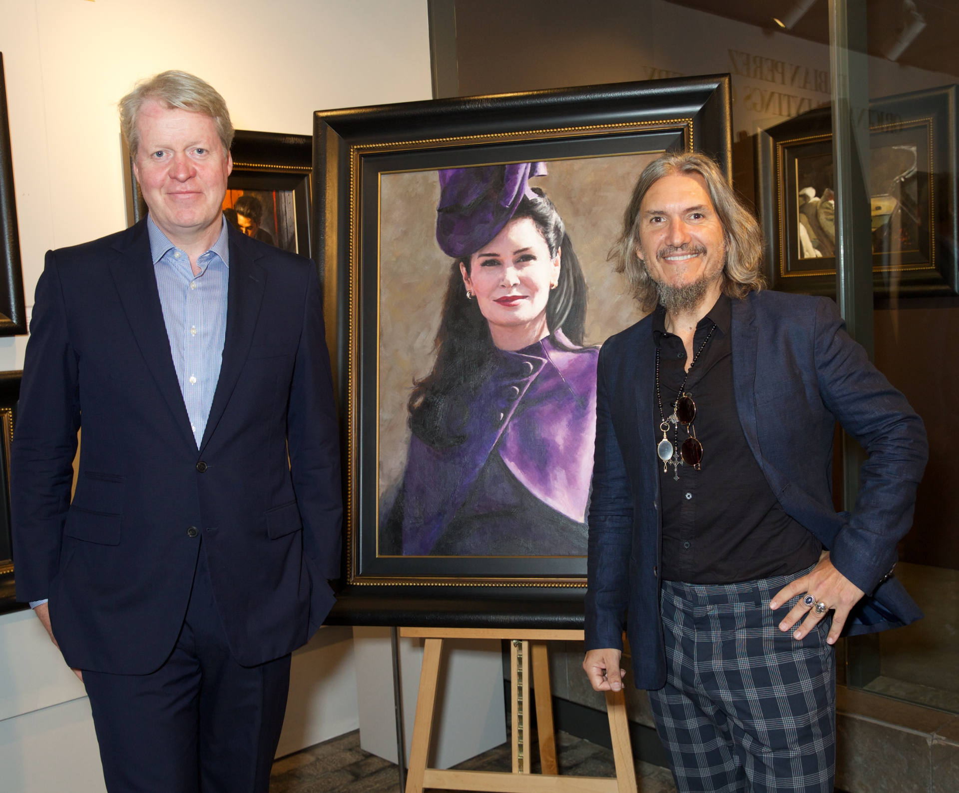Lord Spencer standing in front of Lady Spencer portrait by Fabian Perez