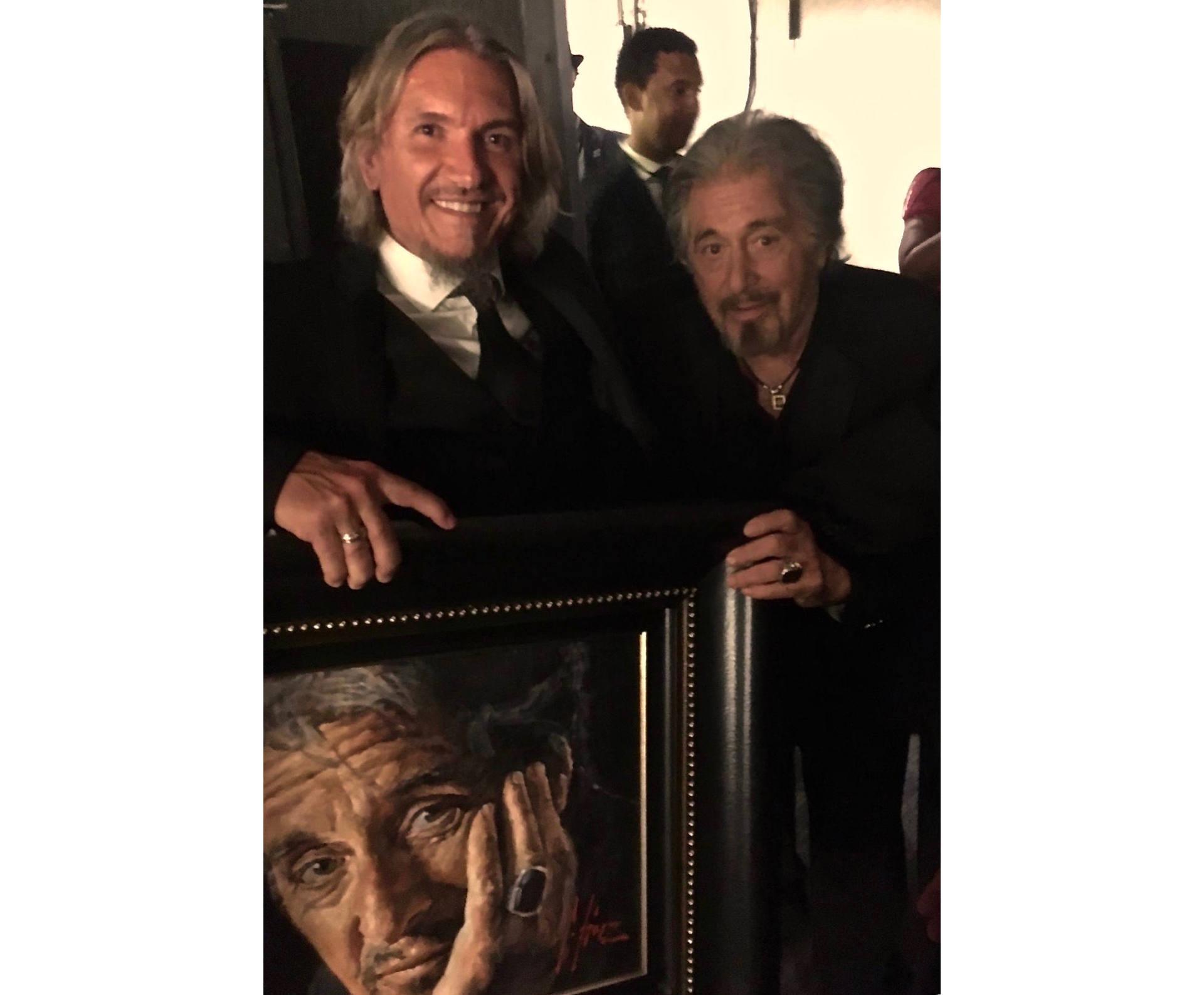 Al Pacino standing next to Fabian Perez holding portrait