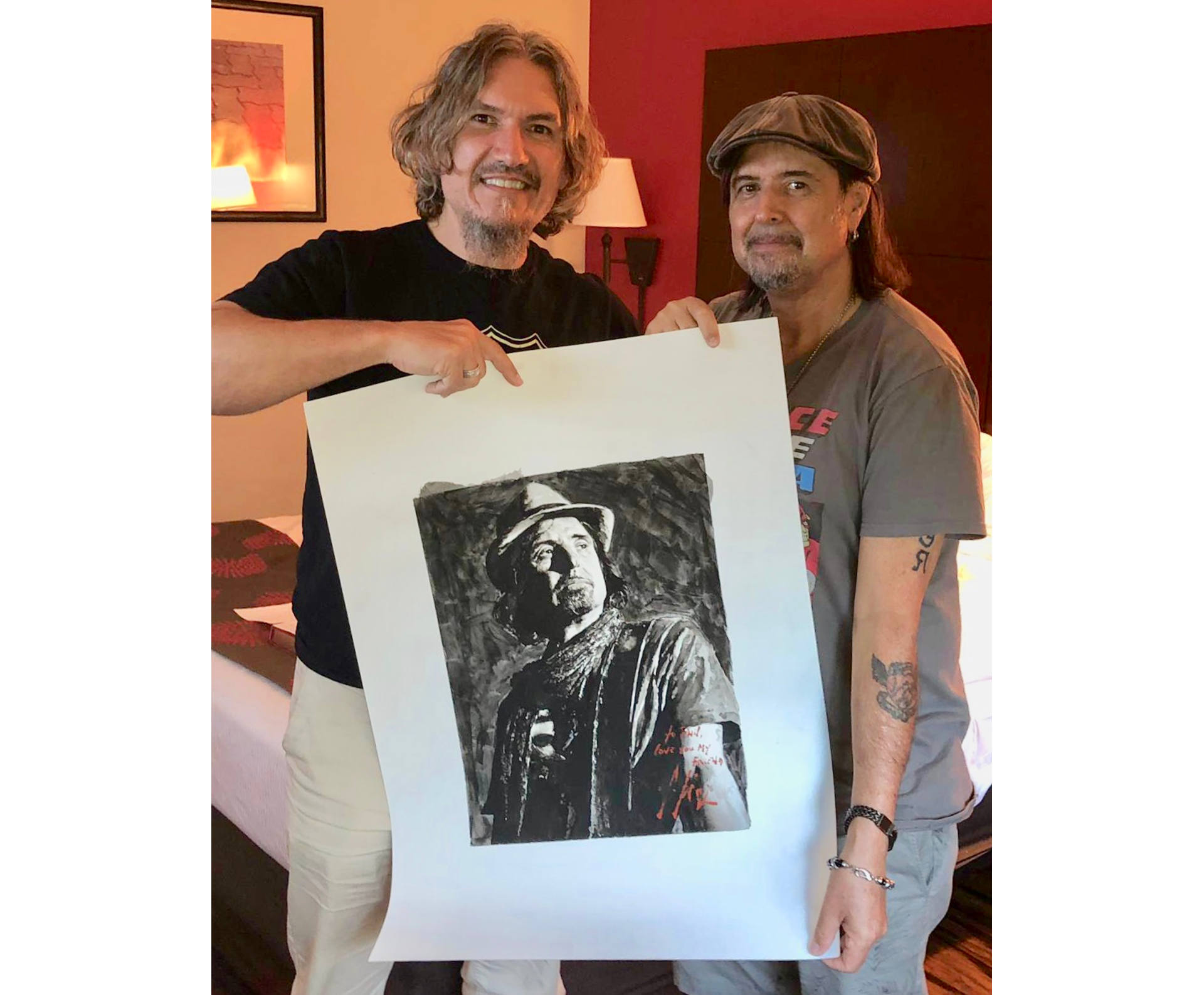 Phil Campbell standing next to Fabian Perez holding portrait