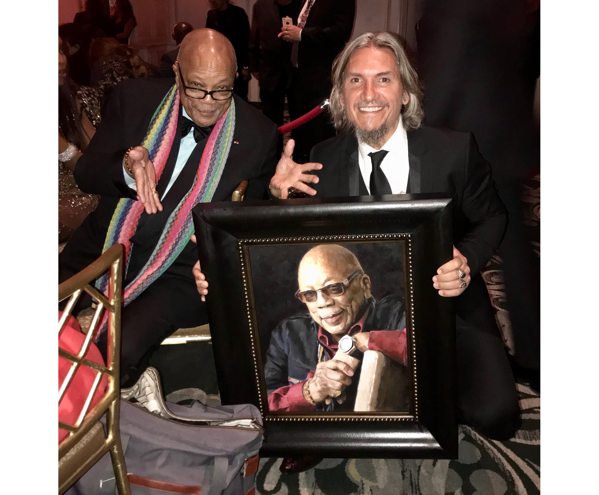Jeff Goldblum holding portrait next to Fabian Perez