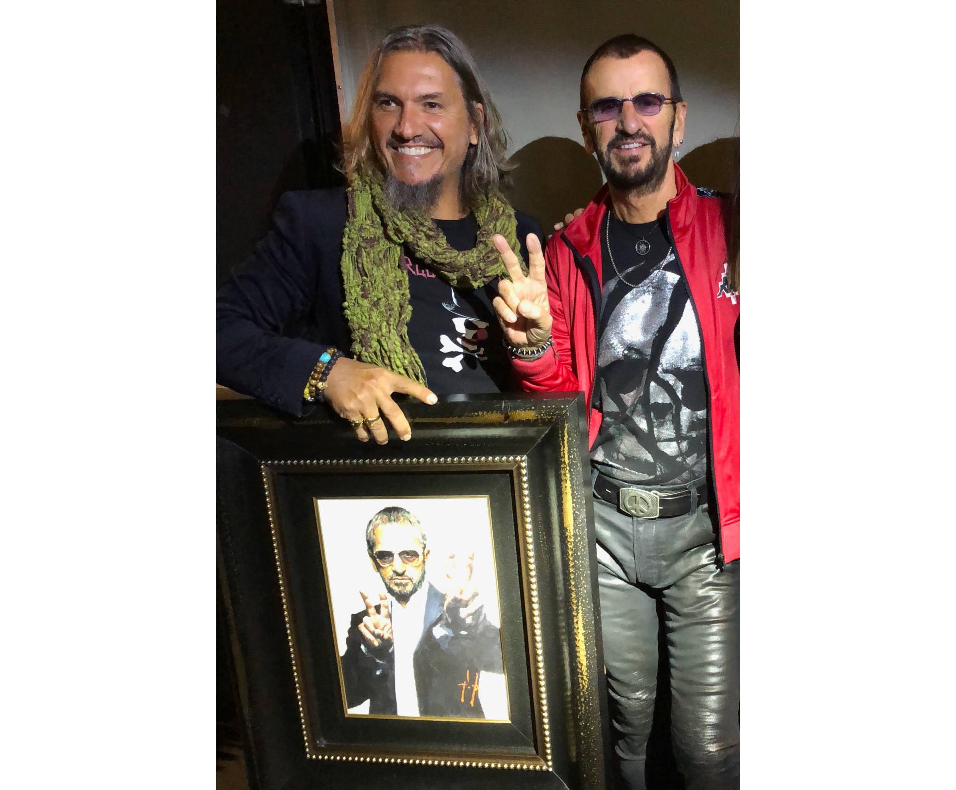 Ringo Starr standing next to Fabian Perez holding portrait