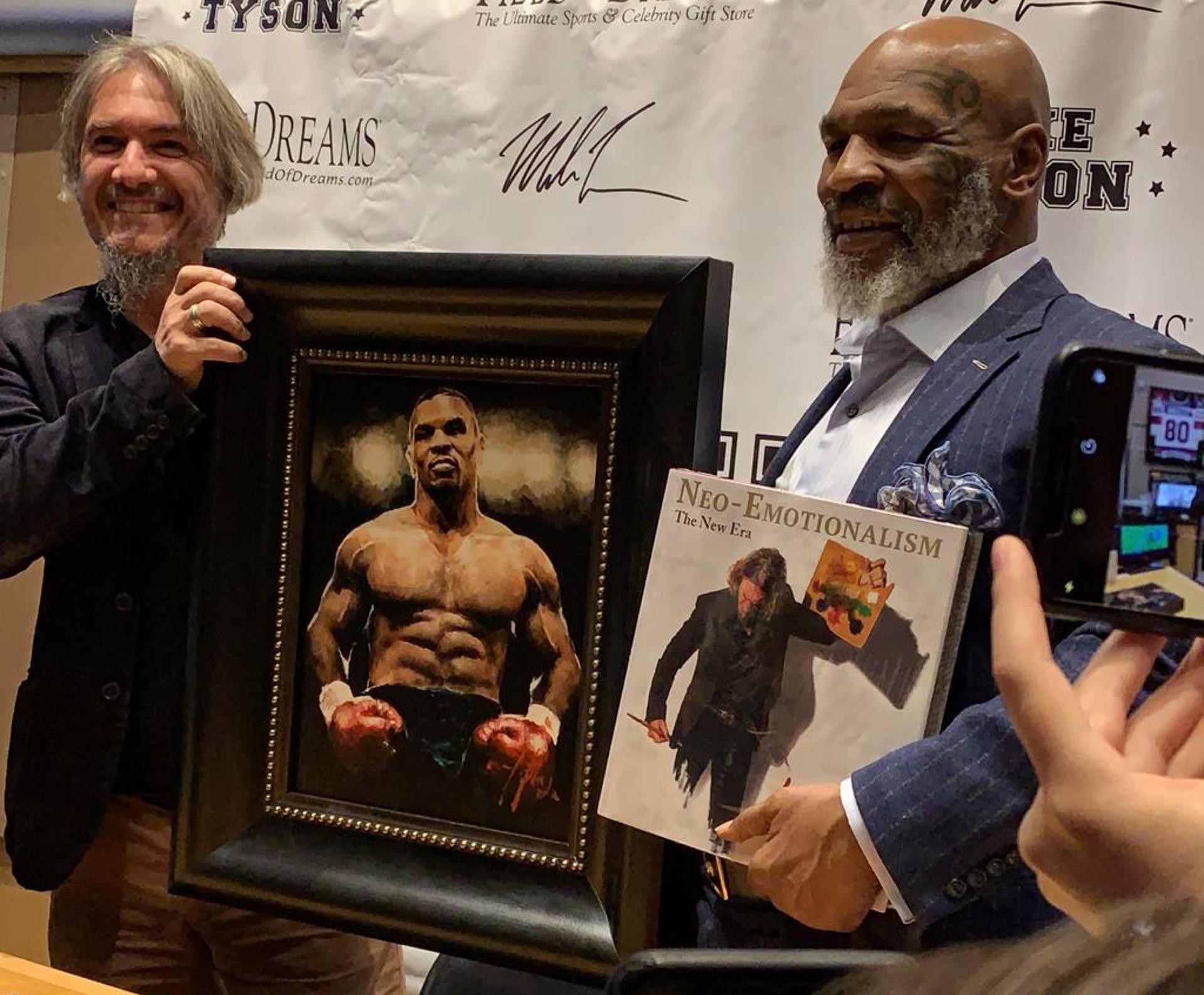 Mike Tyson standing next to Fabian Perez holding portrait