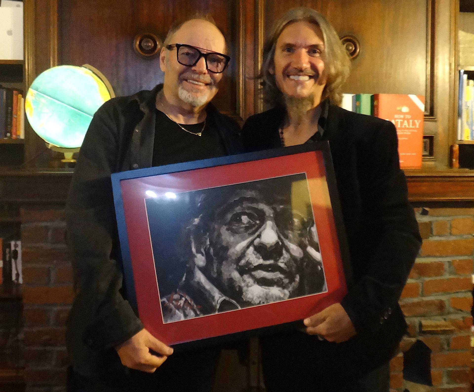 Vasco Rossi standing next to Fabian Perez holding portrait